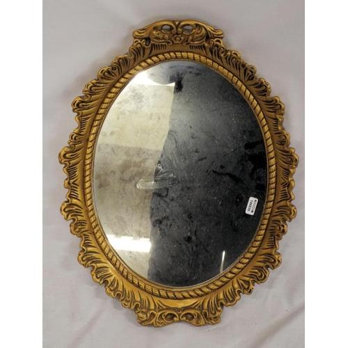 7 - Oval gilt framed foliate decorated wall mirror