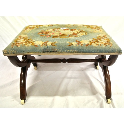 54 - Victorian walnut stool with foliate upholstery and X-shaped frame with turned stretcher