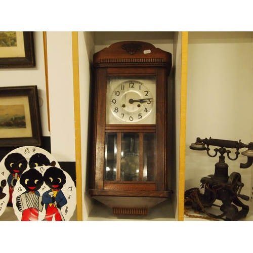 6 - A 1940's mahogany wall clock with key in GWO...