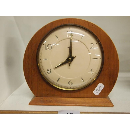 18 - A Smiths 8 day floating balance wooden mantel clock in GWO...