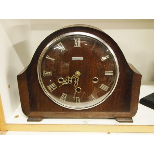 21 - A Smiths wooden mantel clock with key. AF...