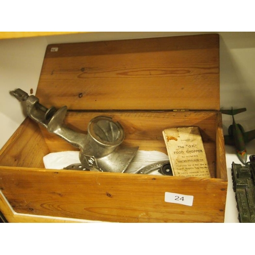 24 - A vintage mincer in its original wooden box...