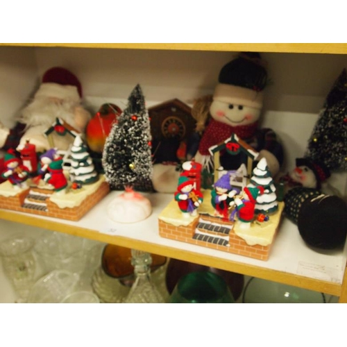 32 - A collection of Christmas decoration items including Santa draft excluders...