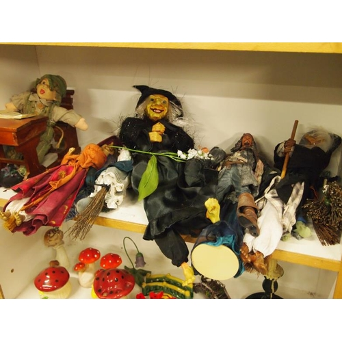 38 - A shelf of various witch dolls and others...