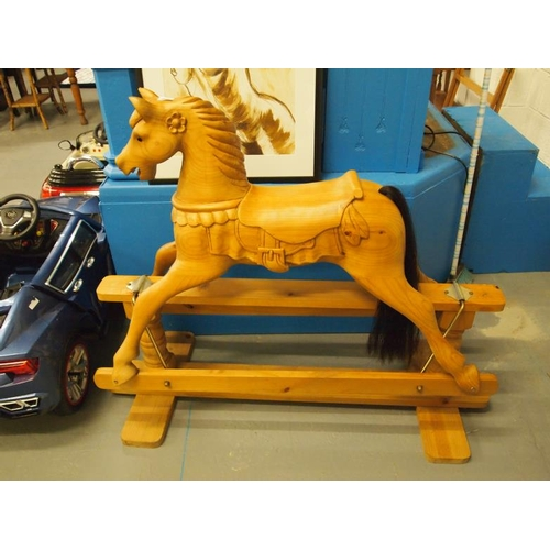 249 - A bespoke commissioned hand carved wooden rocking horse on stand which cost £900 originally...