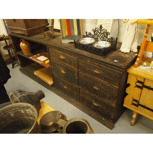 90 - Large turn of the century industrial pine work bench with 6 drawer chest with adjoining shelf unit A...