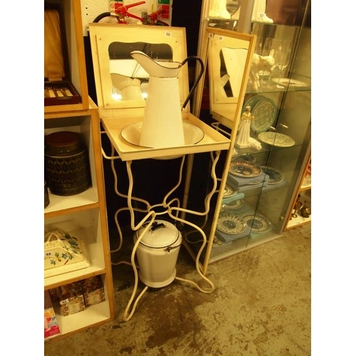 A metal washstand with mirror, wash jug and bowl and a water container