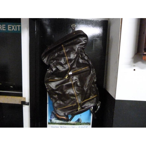 1 - Leather suit carrier...