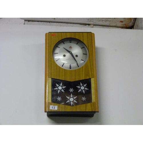 13 - Oriental themed wall clock...