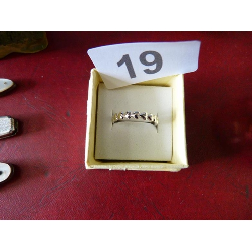19 - Stamped silver ring in heart design...
