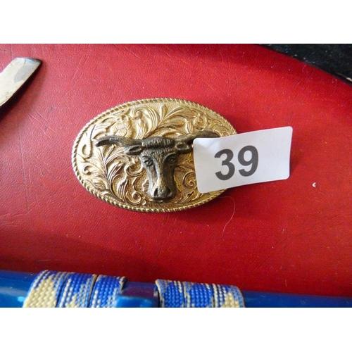 39 - Bull motif belt buckle...