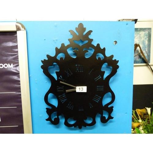 13 - A black wall clock...