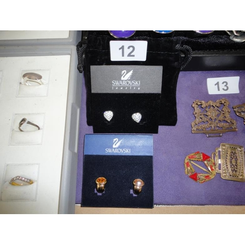 12 - Two brand new pairs of Swarovski earrings...