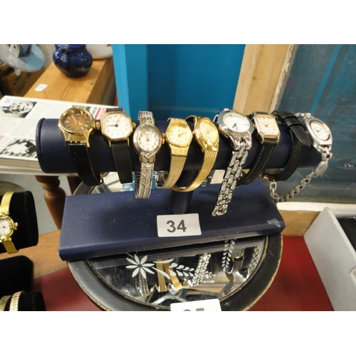 34 - Selection of 9 wristwatches-sold untested...
