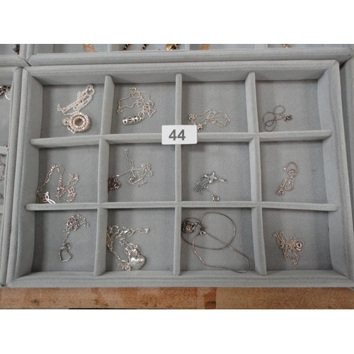 44 - Selection of 12 stamped silver necklaces with various pendants...