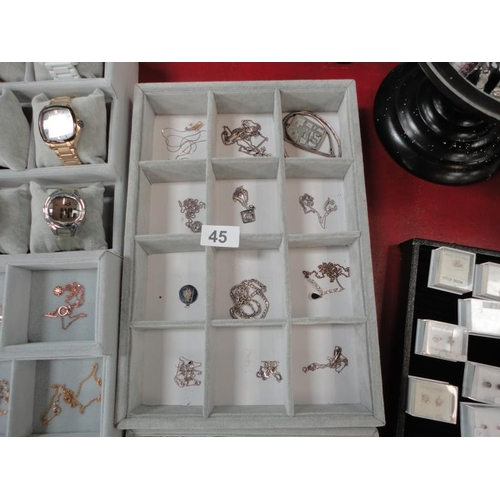 45 - Selection of 12 stamped silver necklaces with various pendants...
