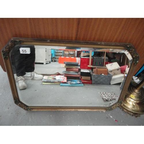 55 - Floral detail gilt framed mirror...