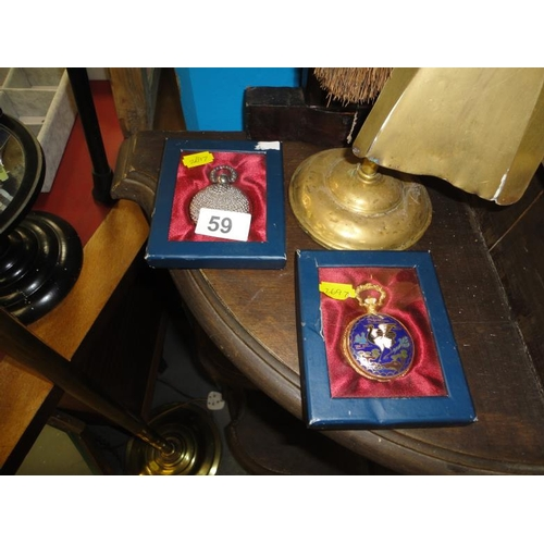 59 - Two pocket watches in boxes, one gold coloured and the other an Oriental crane motif...