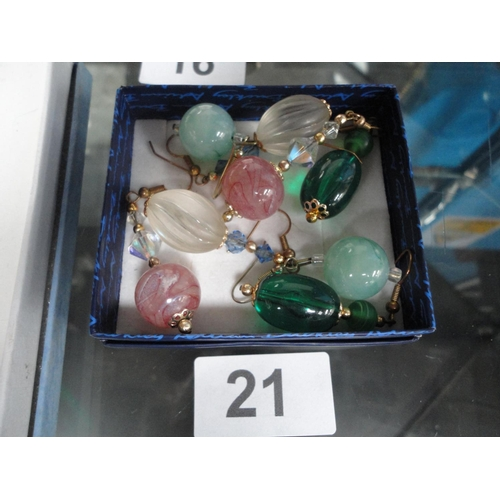 21 - four pairs of colorful earrings...