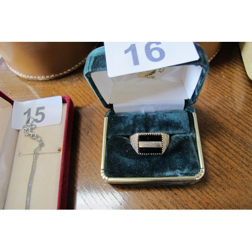 16 - Stamped gold and jet ring with the name Paul engraved on...
