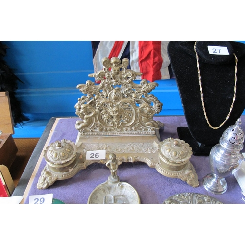 26 - Ornate rococo style brass inkwell and letter holder with cherub motif...