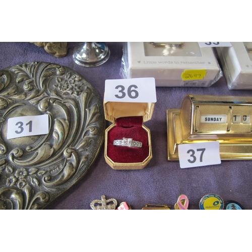 36 - Bling bling costume jewellery ring...