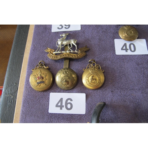 46 - Warwickshire cap badge and photo locket and Canadian button and photo locket...