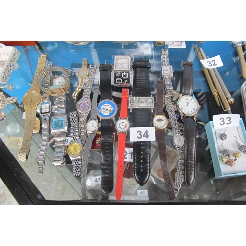 34 - Vast selection of wristwatches-untested...