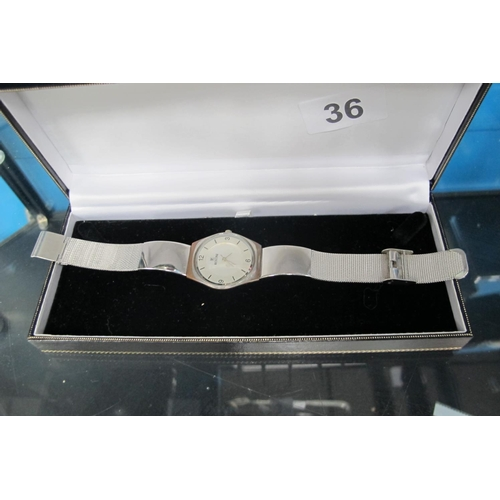36 - Vintage Rostini watch with metal wrist strap...