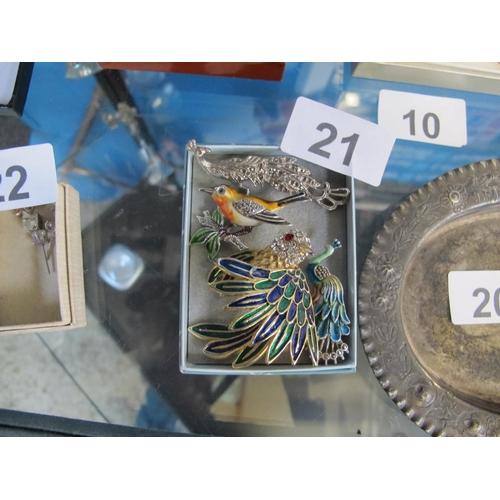 21 - Four bird motif brooches...