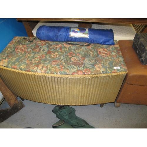 14 - A Lloyd loom style ottoman...
