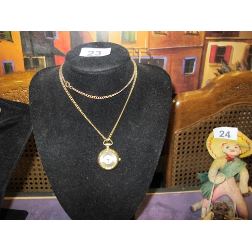 23 - A gold coloured necklace with watch pendant...
