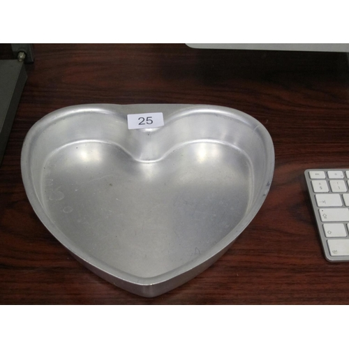 25 - Remember valentines! Heart shaped cake tin...