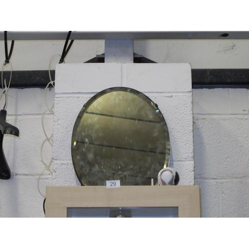 29 - Oval bevelled edge mirror...