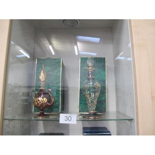 30 - Two boxed Egyptian glass perfume bottles...