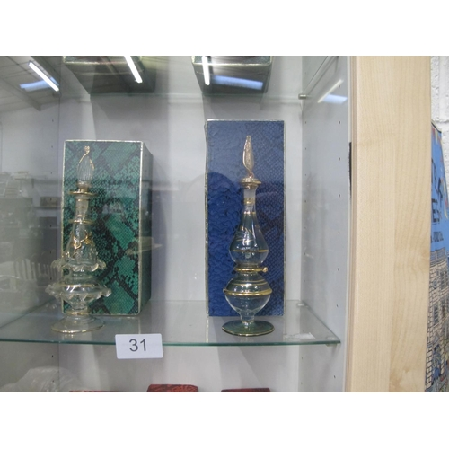 31 - Two boxed Egyptian glass perfume bottles...