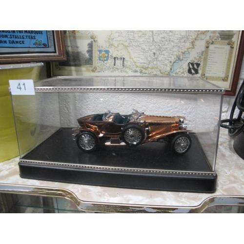 41 - Cased vintage model car...
