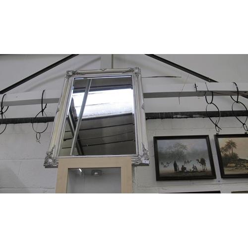 1 - Ornate silver coloured frame bevel edged mirror...