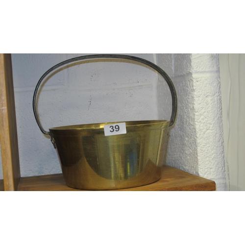 39 - An antique brass jam pan...