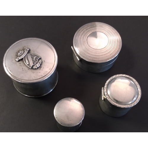 3 - Silver. Circular stamp coil dispensers, 46x33mm with a shield (motto
