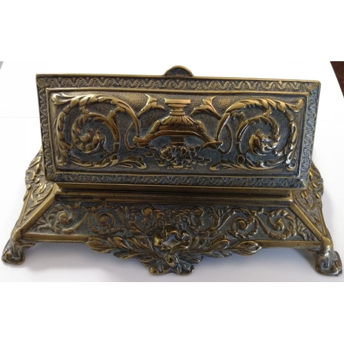 5 - Brass. A large and heavy brass desk stamp box, lifting lid revealing five stamp compartments, ornate...