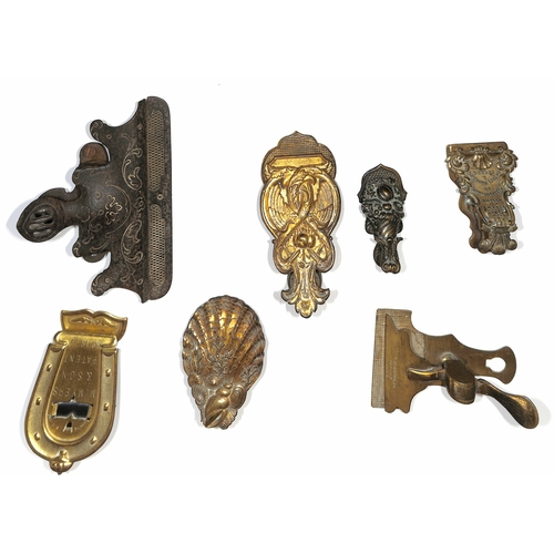 14 - Letter Clips. c.1870 Victorian letter clips, one made of iron, the others all brass, five bearing th...