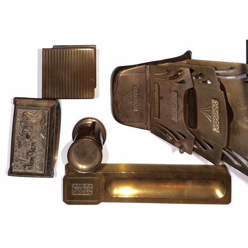 6 - Brass. Desk accessories comprising pen tray with stamp box at one end, stylised leaf pattern to the ...
