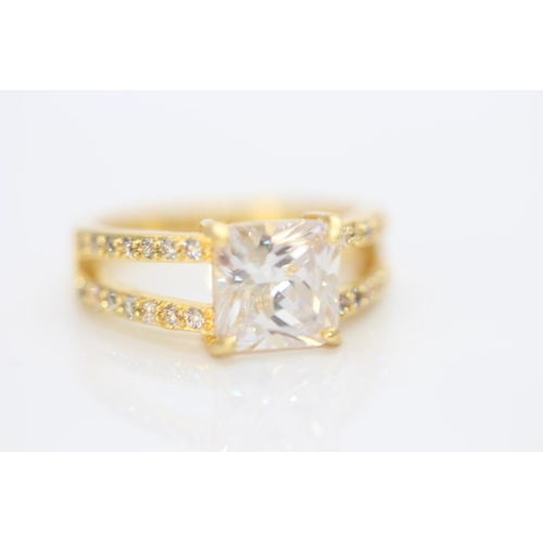 15 - BRAND NEW LADIES AAA CRYSTAL RING, BASE ,METAL WITH YELLOW GOLD GOLD PLATING, RING SIZE- M...