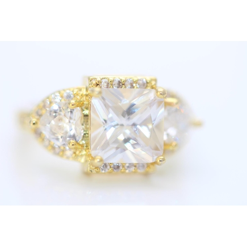 17 - BRAND NEW LADIES AAA CRYSTAL RING, BASE ,METAL WITH YELLOW GOLD GOLD PLATING, RING SIZE- K...