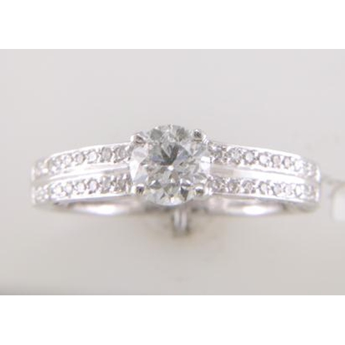 55 - Valued by GIE œ16,315.00 - 18ct White Gold Single Stone Diamond Ring With Double Chanel Set Shoulder...