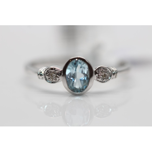 39 - ***£829.00*** 9CT WHITE GOLD LADIES DIAMOND AND TOPAZ RING, RING SIZE- N, DIAMOND WEIGHT- 0.01CT, CO...