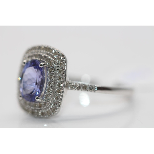 50 - ***£3105.00*** 9CT WHITE GOLD LADIES DIAMOND AND TANZANITE CLUSTER RING, SET WITH 0.33CT OF DIAMONDS...