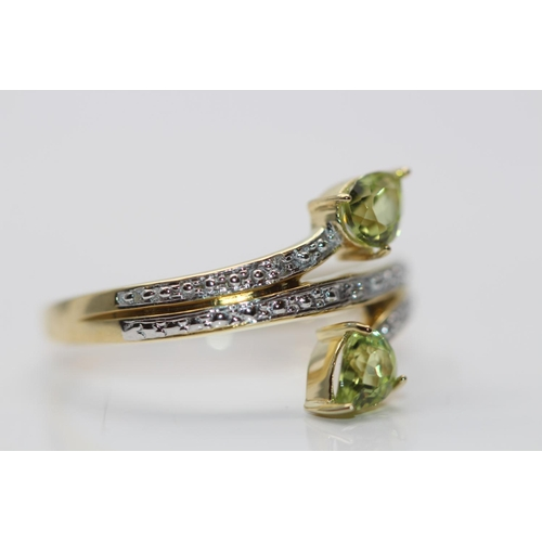 52 - ***£1020.00*** 9CT YELLOW GOLD LADIES DIAMOND AND PERIDOT RING, SET WITH 0.02CT DIAMONDS, COLOUR- D,...