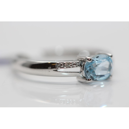 54 - ***£945.00*** 9CT WHITE GOLD LADIES DIAMOND AND TOPAZ RING, SET WITH 0.01CT OF DIMAONDS, RING SIZE- ...